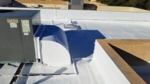 elastomeric roofing applied to a flat roof in Tucson