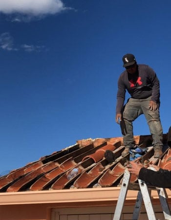 working on a tile roof on a Tucson home