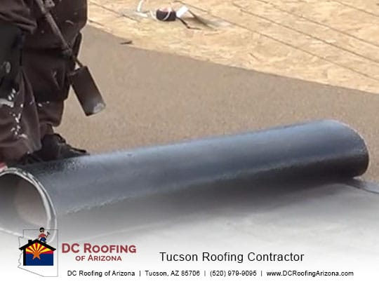 rolled roofing being applied to a flat roof in Tucson, AZ